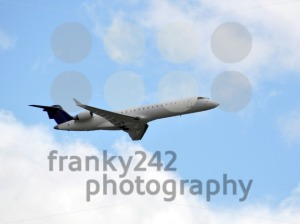 Airplane-in-the-sky-8211-closeup