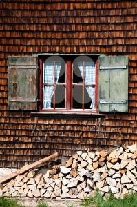 Ancient-window-on-log-house-wooden-wall
