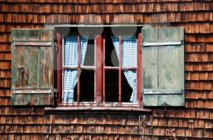 Ancient-window-on-log-house-wooden-wall1