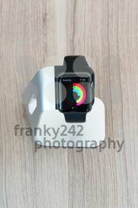 Apple watch in stand displaying mediocre daily activities - franky242 photography