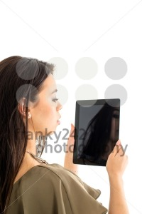 Attractive woman using a tablet computer - franky242 photography