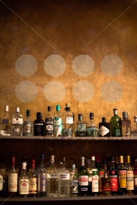 Bar shelves full of alcoholic beverages bottles - franky242 photography