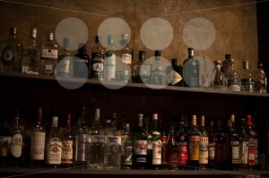 Bar-shelves-full-of-alcoholic-beverages-bottles