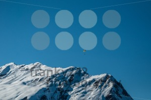 Beautiful Winter Mountain Panorama with Paraglider - franky242 photography