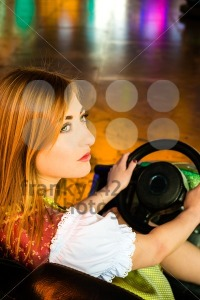 Beautiful girl in an electric bumper car in amusement park - franky242 photography