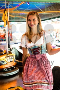 Beautiful girl leaving an electric bumper car in amusement park - franky242 photography