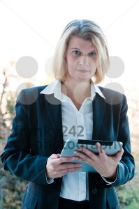 Business woman holding a touchscreen table - franky242 photography