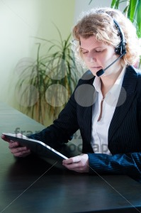 Business woman with digital tablet PC and headset - franky242 photography