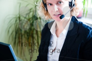 Business woman with laptop and headset - franky242 photography