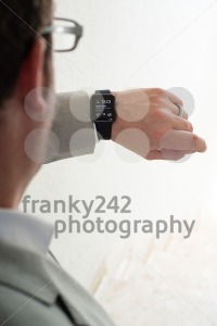Businessman checking his Apple Watch - franky242 photography