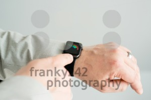 Businessman checking his daily activities using the Apple Watch - franky242 photography