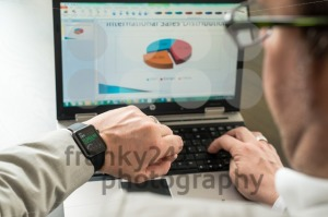 Businessman checking stock market prices on his Apple Watch - franky242 photography