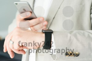 Businessman using the Apple Watch and an Apple iPhone 6 - franky242 photography