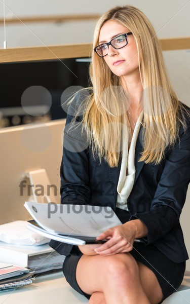 Businesswoman In Office Working On A Document - franky242 photography