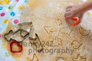 Children Baking Christmas Cookies cutting pastry with a cookie cutter - franky242 photography