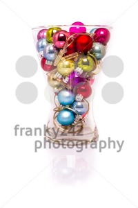Christmas baubles with lights in a vase - franky242 photography