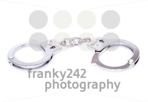 Closed handcuffs on white background - franky242 photography