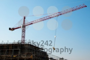 Construction-site-with-crane-and-building
