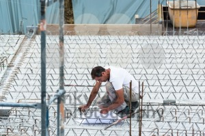 Eengineer checking a blueprint on a construction site - franky242 photography