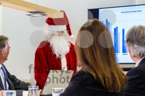 Female Santa Claus presenting in business meeting - franky242 photography