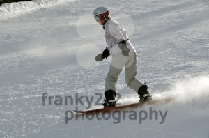 Female snowboarder in powder snow - franky242 photography