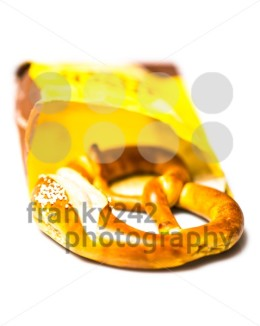 Fresh German pretzel  out of its paper bag on white