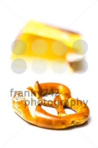 Fresh German pretzel  out of its paper bag on white - franky242 photography