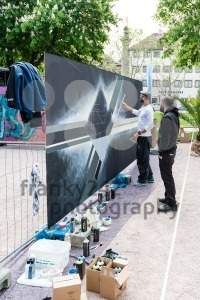Graffiti artist spraying the wall - franky242 photography