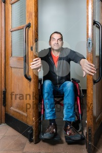 Man in wheelchair stuck between swing doors - franky242 photography