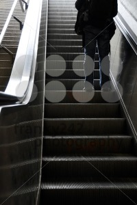 Man-moving-up-with-escalator