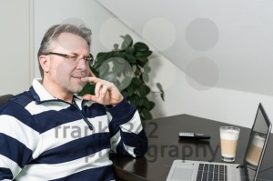 Man working from home on laptop computer - franky242 photography