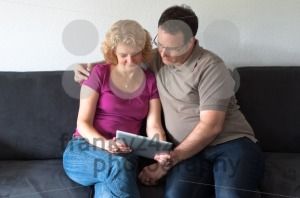 Middle-aged couple with digital tablet pc - franky242 photography