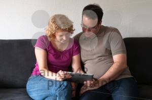 Middle-aged-couple-with-digital-tablet-pc