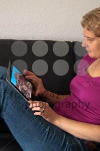 Middle-aged-woman-with-digital-tablet-pc1
