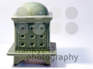 Miniature-model-of-a-tiled-stove-on-white