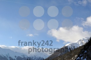 Mountain panorama with trees, snow and clouds - franky242 photography