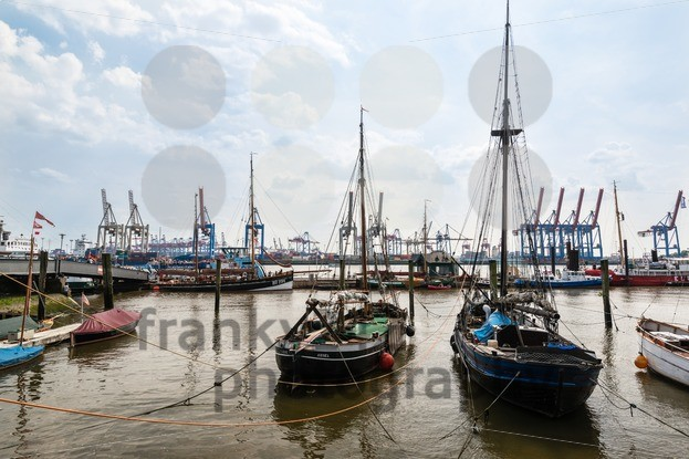 old sailing ships in front of modern container terminals franky242