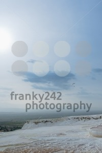 Paragliders over the travertine pools in Pamukkale, Turkey - franky242 photography