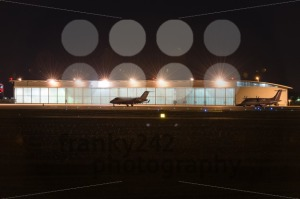 Private jets parked in front of hangar at nigt - franky242 photography