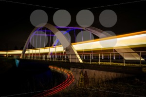 Railway bridge with train and car lights  at night - franky242 photography