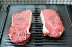Raw beef steaks on the barbecue - franky242 photography
