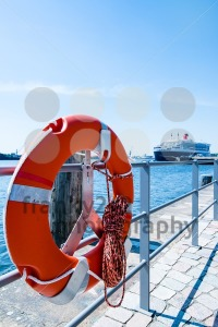 Red Lifebuoy in front of cruise ship - franky242 photography