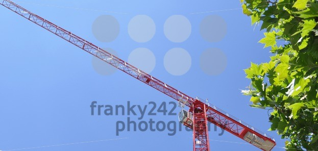 Red-tower-construction-crane-with-bushes