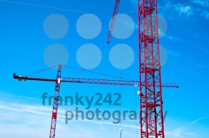Red-tower-construction-cranes