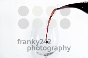 Red wine pouring into a glass - franky242 photography