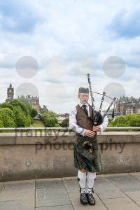 Scottish Bagpiper in Edinburgh with the city in the background - franky242 photography