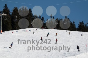 Skier and snowboarder on skiing slope - franky242 photography