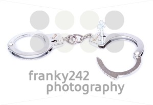 Steel handcuffs isolated on white background - franky242 photography