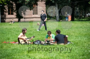 Students playing guitar and having fun in the park - franky242 photography