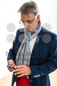 Stylish pensioner checking his mobile phone - franky242 photography